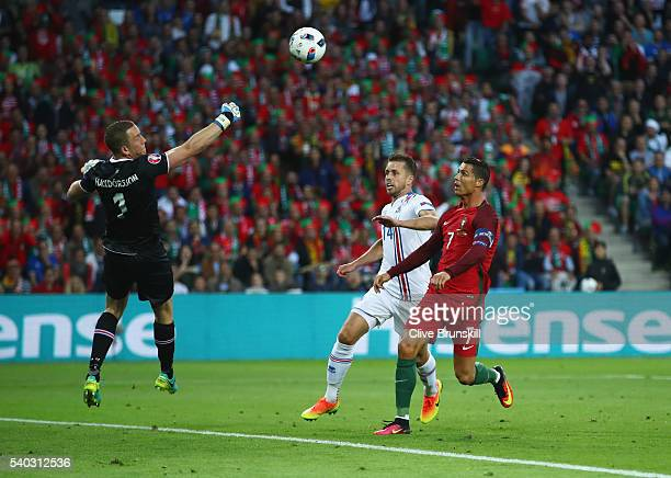 Cristiano Ronaldo of Portugal misses a chance as Hannes Halldorsson and Kari Arnason of Iceland challenge during the UEFA EURO 2016 Group F match...