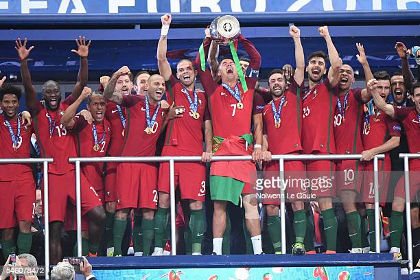 Cristiano Ronaldo of Portugal Portugal team celebrate during the European Championship Final between Portugal and France at Stade de France on July...