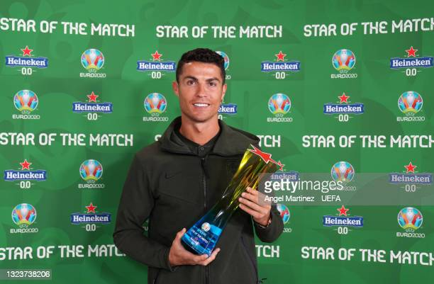 """Cristiano Ronaldo of Portugal poses for a photograph with their Heineken """"Star of the Match"""" award after the UEFA Euro 2020 Championship Group F..."""