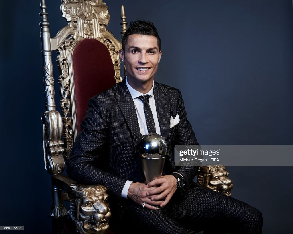 Cristiano Ronaldo of Portugal poses with The Best FIFA Men's Player 2017 trophy during The Best FIFA Football Awards at the London Palladium on October 23, 2017 in London, England.