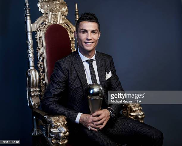 Cristiano Ronaldo of Portugal poses with The Best FIFA Men's Player 2017 trophy during The Best FIFA Football Awards at the London Palladium on...