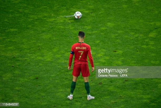 Cristiano Ronaldo of Portugal prepares to take a free kick during the UEFA Nations League Final between Portugal and the Netherlands at Estadio do...