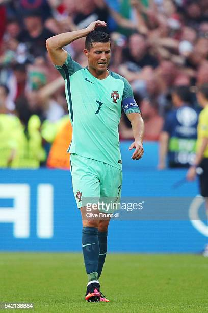 Cristiano Ronaldo of Portugal reacts after Hungary's third goal during the UEFA EURO 2016 Group F match between Hungary and Portugal at Stade des...