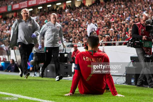 Cristiano Ronaldo of Portugal reacts after injuring himself during the 2020 UEFA European Championships group B qualifying match between Portugal and...