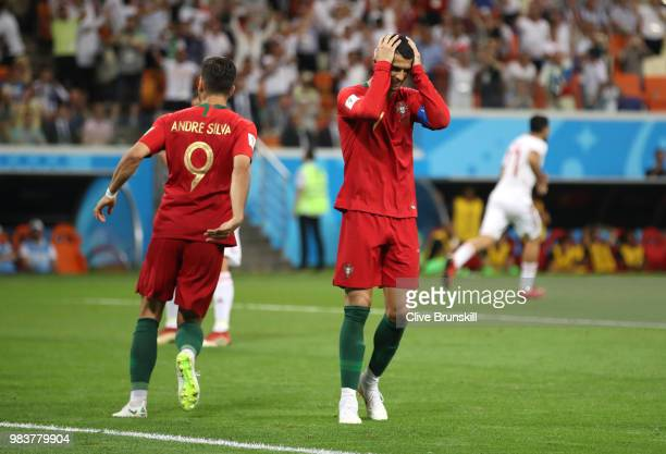 Cristiano Ronaldo of Portugal reacts after missing a penalty during the 2018 FIFA World Cup Russia group B match between Iran and Portugal at...