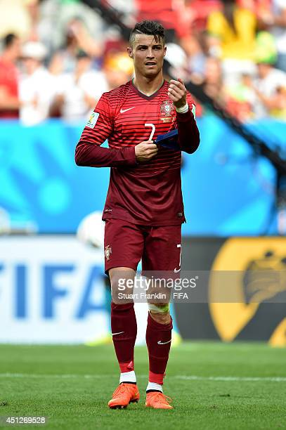 Cristiano Ronaldo of Portugal reacts as he walks off the pitch after the 2014 FIFA World Cup Brazil Group G match between Portugal and Ghana at...