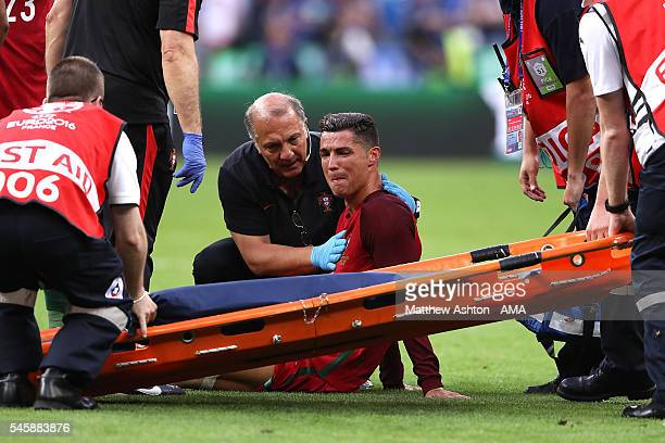 Cristiano Ronaldo of Portugal reacts to an injury during the UEFA Euro 2016 Final match between Portugal and France at Stade de France on July 10...
