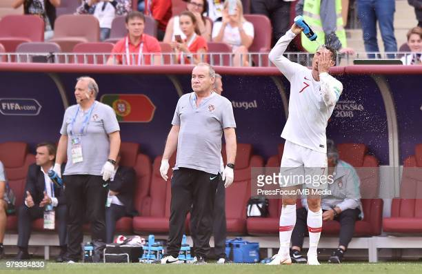Cristiano Ronaldo of Portugal refreshes himself down during the 2018 FIFA World Cup Russia group B match between Portugal and Morocco at Luzhniki...