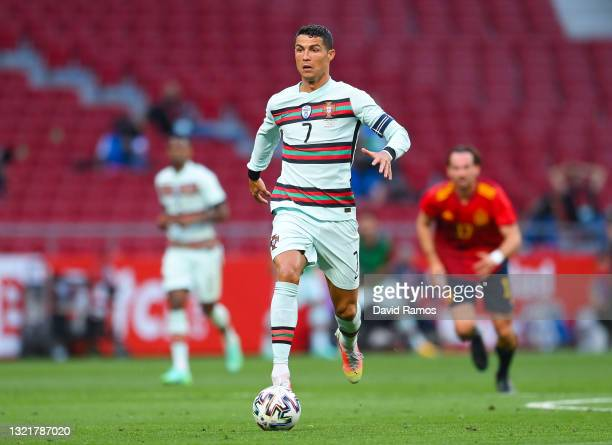 Cristiano Ronaldo of Portugal runs with the ball during the international friendly match between Spain and Portugal at Wanda Metropolitano stadium on...