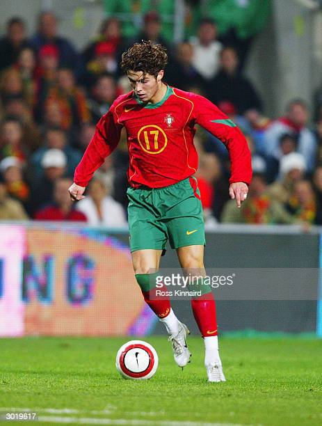 Cristiano Ronaldo of Portugal runs with the ball during the International Friendly match between Portugal and England held on February 18, 2004 at...