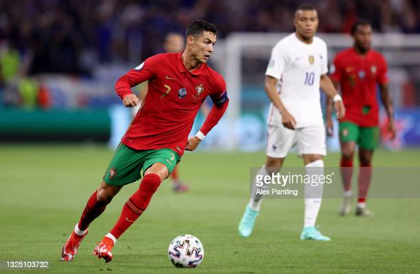 Cristiano Ronaldo of Portugal runs with the ball during the UEFA Euro 2020 Championship Group F match between Portugal and France at Puskas Arena on...