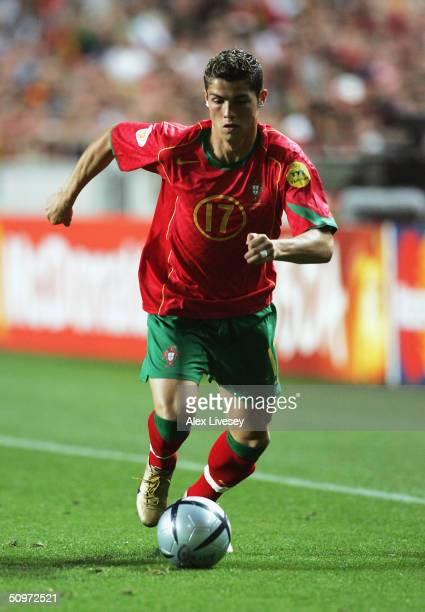 Cristiano Ronaldo of Portugal runs with the ball during the UEFA Euro 2004 Group A match between Russia and Portugal at the Luz Stadium on June 16...