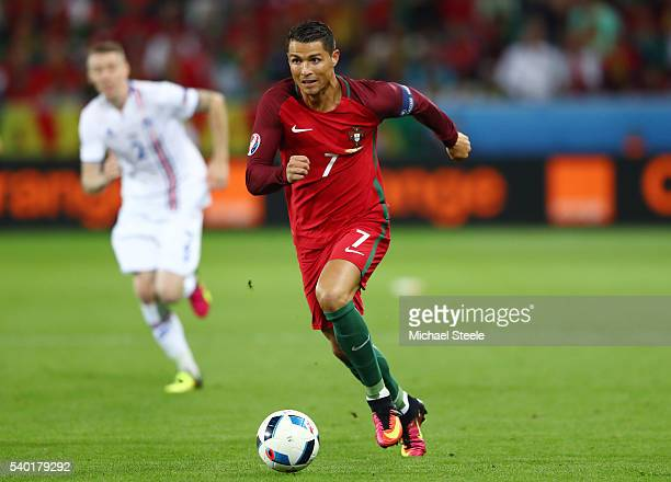 Cristiano Ronaldo of Portugal runs with the ball during the UEFA EURO 2016 Group F match between Portugal and Iceland at Stade GeoffroyGuichard on...