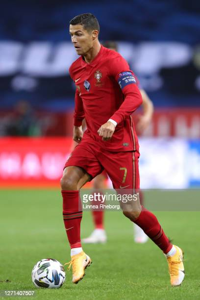 Cristiano Ronaldo of Portugal runs with the ball during the UEFA Nations League group stage match between Sweden and Portugal at Friends Arena on...