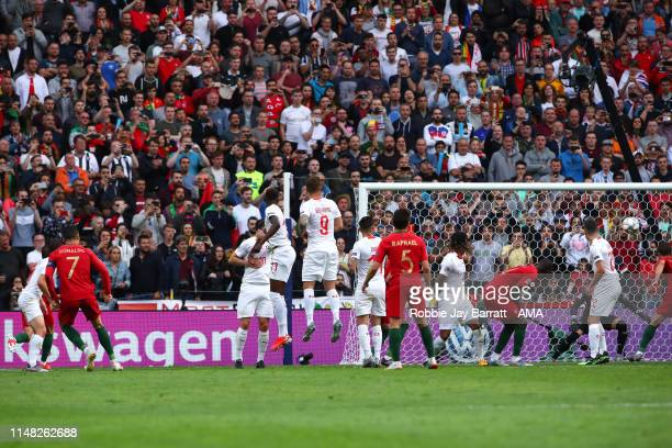 Cristiano Ronaldo of Portugal scores a goal to make it 1-0 from a free kick during the UEFA Nations League Semi-Final match between Portugal and...