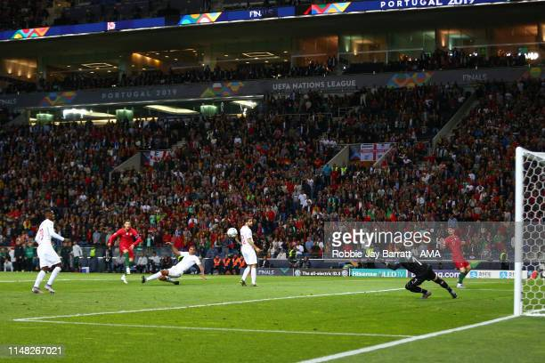 Cristiano Ronaldo of Portugal scores a goal to make it 3-1 during the UEFA Nations League Semi-Final match between Portugal and Switzerland at...