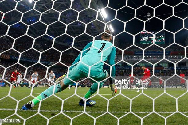 Cristiano Ronaldo of Portugal scores a penalty for his team's first goal past David De Gea of Spain during the 2018 FIFA World Cup Russia group B...