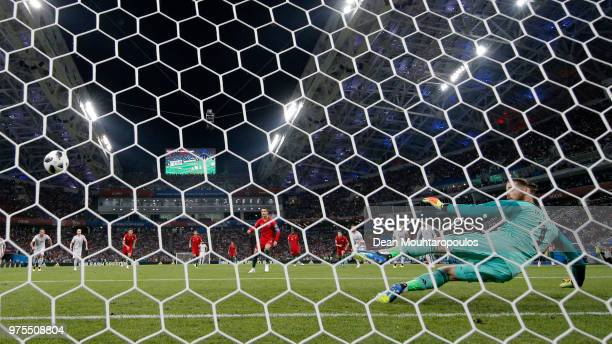 Cristiano Ronaldo of Portugal scores a penalty past David De Gea of Spain for his team's first goal during the 2018 FIFA World Cup Russia group B...