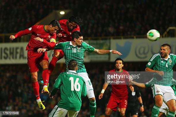 Cristiano Ronaldo of Portugal scores during the FIFA 2014 World Cup Qualifying Group F match between Northern Ireland and Portugal at Windsor Park on...
