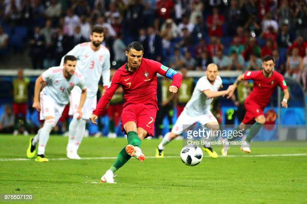 Cristiano Ronaldo of Portugal scores his side's first goal from the penalty spot during the 2018 FIFA World Cup Russia group B match between Portugal...