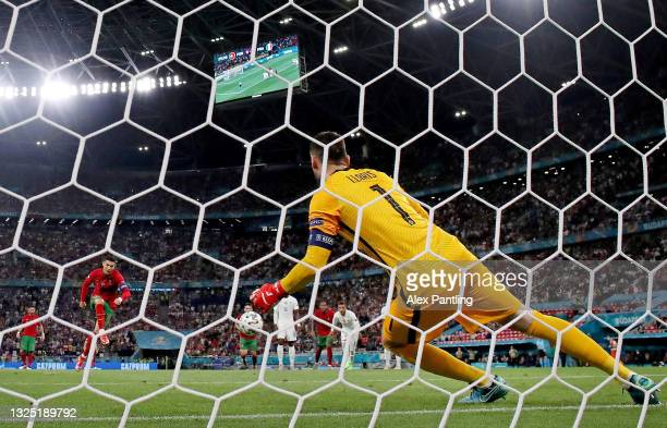 Cristiano Ronaldo of Portugal scores his sides first goal past Hugo Lloris if France from the penalty spot during the UEFA Euro 2020 Championship...