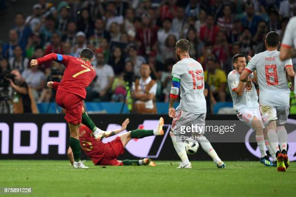 Cristiano Ronaldo of Portugal scores his side's second goal and during the 2018 FIFA World Cup Russia group B match between Portugal and Spain at...