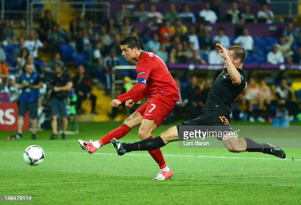 Cristiano Ronaldo of Portugal scores his team's first goal during the UEFA EURO 2012 group B match between Portugal and Netherlands at Metalist...