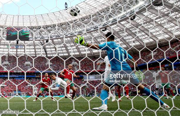 Cristiano Ronaldo of Portugal scores his team's first goal past Monir El Kajoui during the 2018 FIFA World Cup Russia group B match between Portugal...