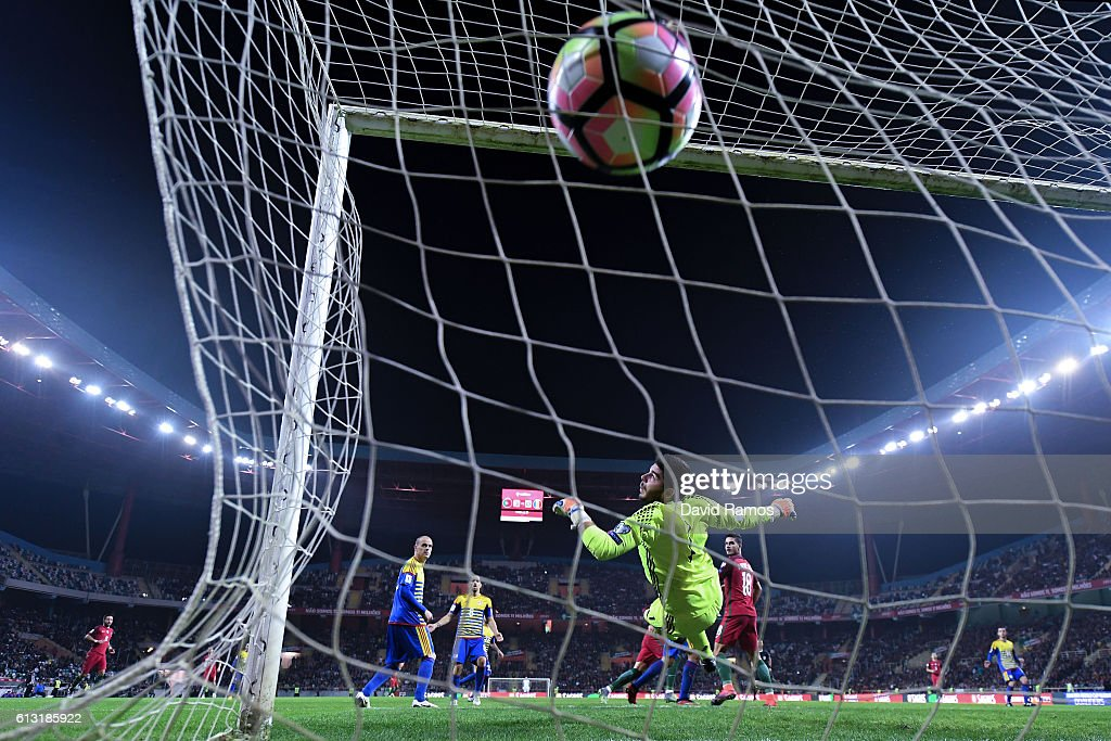 Cristiano Ronaldo of Portugal scores his team's fourth goal during the FIFA 2018 World Cup Qualifier between Portugal and Andorra at Estadio Municipal de Aveiro on October 7, 2016 in Aveiro, Portugal.