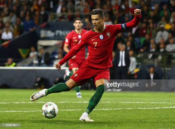 Cristiano Ronaldo of Portugal scores his team's second goal during the UEFA Nations League SemiFinal match between Portugal and Switzerland at...