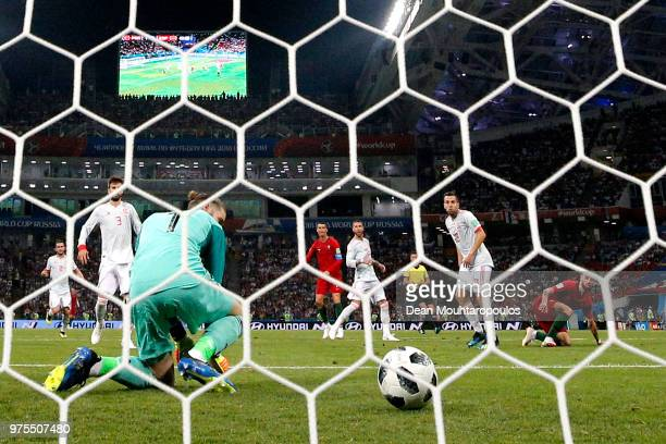 Cristiano Ronaldo of Portugal scores his team's second goal past David De Gea of Spain during the 2018 FIFA World Cup Russia group B match between...