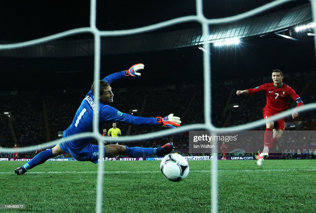 Cristiano Ronaldo of Portugal scores his team's second goal past Maarten Stekelenburg of Netherlands during the UEFA EURO 2012 group B match between Portugal and Netherlands at Metalist Stadium on June 17, 2012 in Kharkov, Ukraine.