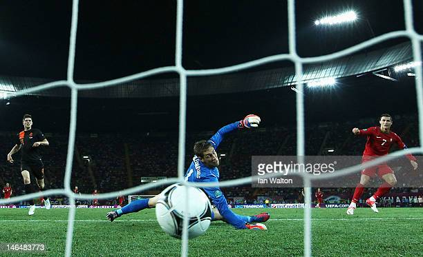 Cristiano Ronaldo of Portugal scores his team's second goal past Maarten Stekelenburg of Netherlands during the UEFA EURO 2012 group B match between...