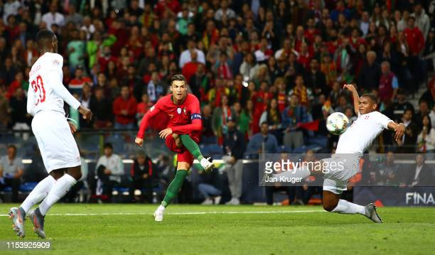 Cristiano Ronaldo of Portugal scores his team's third goal and completes his hat trick during the UEFA Nations League SemiFinal match between...