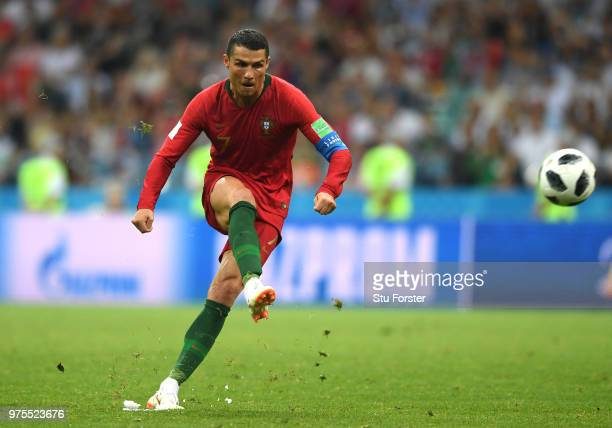 Cristiano Ronaldo of Portugal scores his team's third goal during the 2018 FIFA World Cup Russia group B match between Portugal and Spain at Fisht...