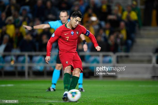 Cristiano Ronaldo of Portugal scores the first goal against Lithuania during the UEFA Euro 2020 Qualifier match between Portugal and Lithuania at...
