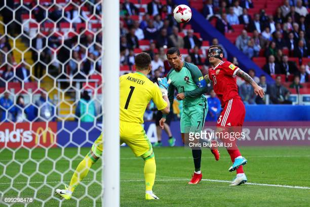 Cristiano Ronaldo of Portugal scores the opening goal during the FIFA Confederations Cup Russia 2017 Group A match between Russia and Portugal at...