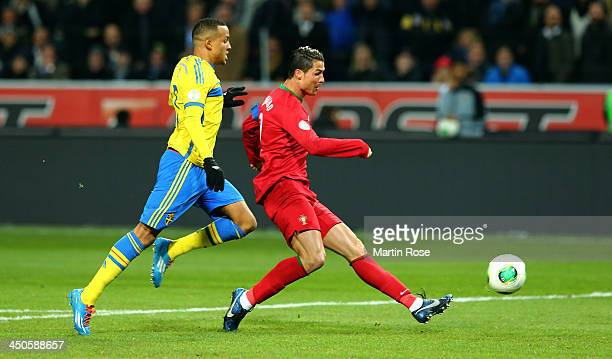 Cristiano Ronaldo of Portugal scores their opening goal during the FIFA 2014 World Cup Qualifier Play-off Second Leg match between Sweden and...