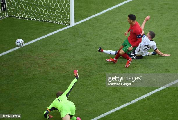 Cristiano Ronaldo of Portugal scores their side's first goal during the UEFA Euro 2020 Championship Group F match between Portugal and Germany at...