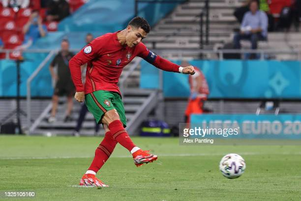 Cristiano Ronaldo of Portugal scores their side's first goal from the penalty spot during the UEFA Euro 2020 Championship Group F match between...
