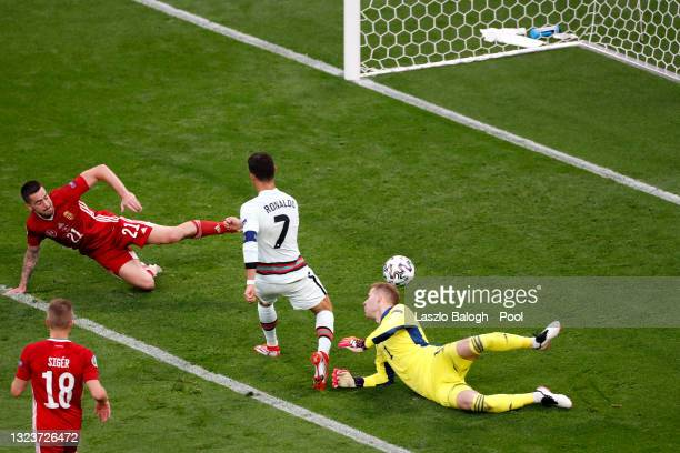 Cristiano Ronaldo of Portugal scores their side's third goal past Peter Gulacsi of Hungary during the UEFA Euro 2020 Championship Group F match...