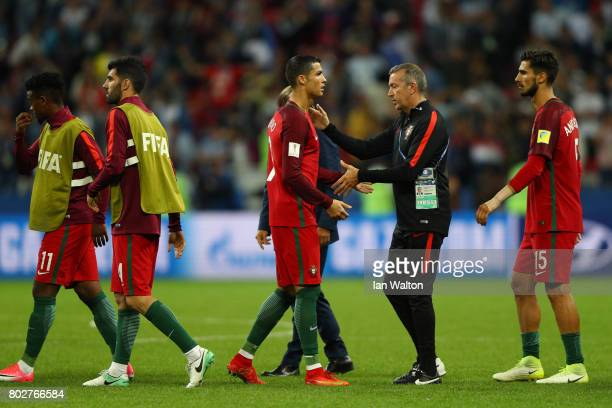 Cristiano Ronaldo of Portugal shakes hands with a team staff after his side's defeat through the penalty shootout in the FIFA Confederations Cup...