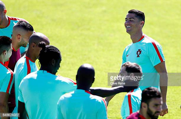 Cristiano Ronaldo of Portugal shares a joke with his team mates during a training session ahead of the UEFA Euro 2016 Final against France at the...