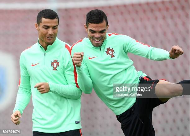 Cristiano Ronaldo of Portugal shares a joke with Pepe during a training session at Stadium Rubin on June 27 2017 in Kazan Russia