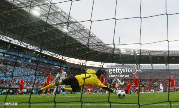 Cristiano Ronaldo of Portugal shoots and scores his teams second goal during the UEFA EURO 2008 Group A match between Czech Republic and Portugal at...