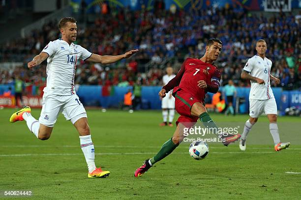 Cristiano Ronaldo of Portugal shoots at goal during the UEFA Euro 2016 Group F match between Portugal and Iceland at Stade GeoffroyGuichard on June...