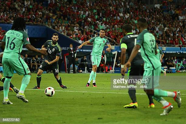 Cristiano Ronaldo of Portugal shoots prior to Nani scoring a goal to make the score 2-0 during the UEFA Euro 2016 Semi Final match between Portugal...