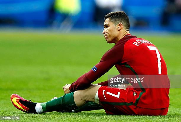 Cristiano Ronaldo of Portugal shows his emotion before being substituted due to injury during the UEFA EURO 2016 Final match between Portugal and...