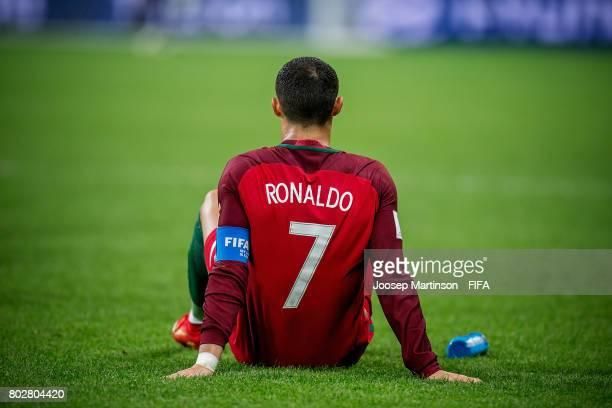 Cristiano Ronaldo of Portugal sits on the pitch during half time of extra time during FIFA Confederations Cup Russia semifinal match between Portugal...