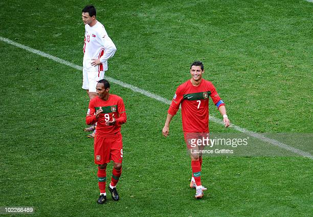 Cristiano Ronaldo of Portugal smiles after he scores his team's sixth goal with team mate Liedson during the 2010 FIFA World Cup South Africa Group G...